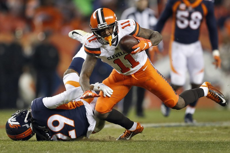 Cleveland Browns wide receiver Antonio Callaway (11) makes a catch as Denver Broncos cornerback Bradley Roby (29) defends during the second half of an NFL football game, Saturday, Dec. (AP Photo/Jack Dempsey)