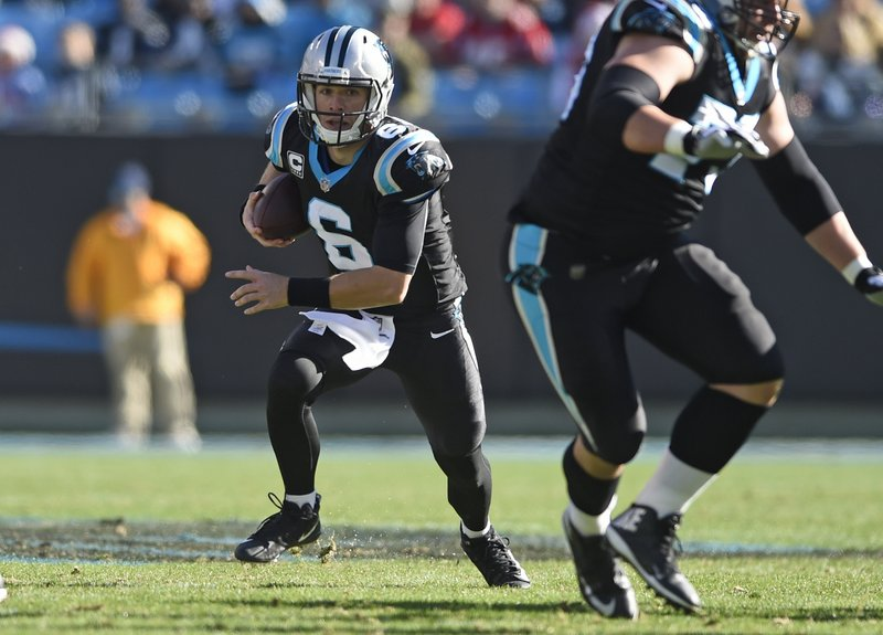 File-This file  photo taken Dec. 23, 2018, shows Carolina Panthers' Taylor Heinicke (6) running against the Atlanta Falcons during the first half of an NFL football game in Charlotte, N. (AP Photo/Mike McCarn)