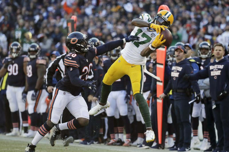 FILE - In this Dec. 16, 2018, file photo, Green Bay Packers wide receiver Davante Adams (17) makes a catch against Chicago Bears cornerback Prince Amukamara (20) during the second half of an NFL football game in Chicago. (AP Photo/Nam Y. Huh, File)