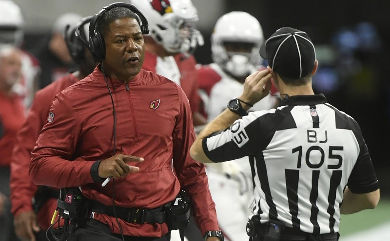 File-This Dec. 16, 2018, file photo shows Arizona Cardinals head coach Steve Wilks speaking to field judge Rick Patterson (15) during the first half of an NFL football game in Atlanta. (3-12) and may spell an end to Wilks tenure as their head coach. It's been an underwhelming season for the Cardinals and the struggles have led to plenty of rumors that Wilks will only last one season.  (AP Photo/John Amis, File)