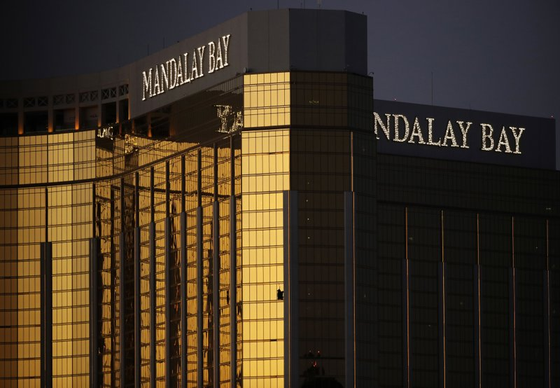 FILE - In this Oct. 3, 2017, file photo, windows are broken at the Mandalay Bay resort and casino in Las Vegas, the room from where Stephen Craig Paddock fired on a nearby music festival, killing 58 and injuring hundreds on Oct. (AP Photo/John Locher, File)
