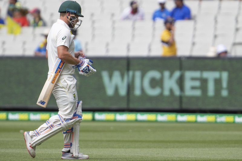 Australia's Aaron Finch walks off the field after being caught out for 8 runs during play on day three of the third cricket test between India and Australia in Melbourne, Australia, Friday, Dec. (AP Photo/Asanka Brendon Ratnayake)