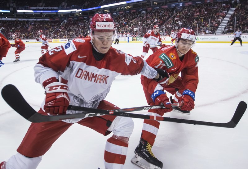 Denmark's Magnus Koch, left, and Russia's Ivan Morozov vie for the puck during the third period of a world junior hockey championship game Thursday, Dec. (Darryl Dyck/The Canadian Press via AP)
