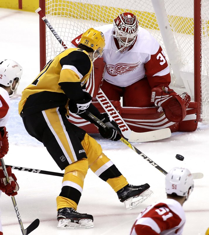 Pittsburgh Penguins' Evgeni Malkin (71) can't get off a shot in front of Detroit Red Wings goaltender Jimmy Howard (35) during the first period of an NHL hockey game in Pittsburgh, Thursday, Dec. (AP Photo/Gene J. Puskar)
