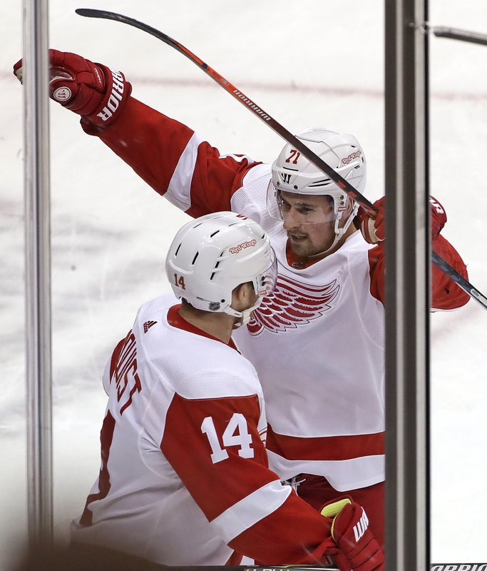 Detroit Red Wings' Dylan Larkin (71) celebrates his goal with Gustav Nyquist (14) during the first period of an NHL hockey game against the Pittsburgh Penguins in Pittsburgh, Thursday, Dec. (AP Photo/Gene J. Puskar)