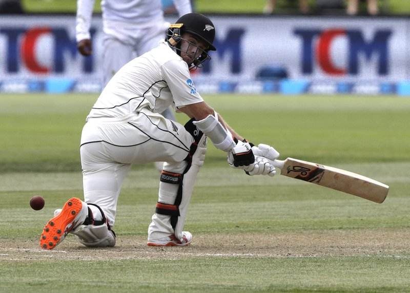 New Zealand's Tom Latham plays a sweep shot during play on day three of the second cricket test between New Zealand and Sri Lanka at Hagley Oval in Christchurch, New Zealand, Friday, Dec. (AP Photo/Mark Baker)