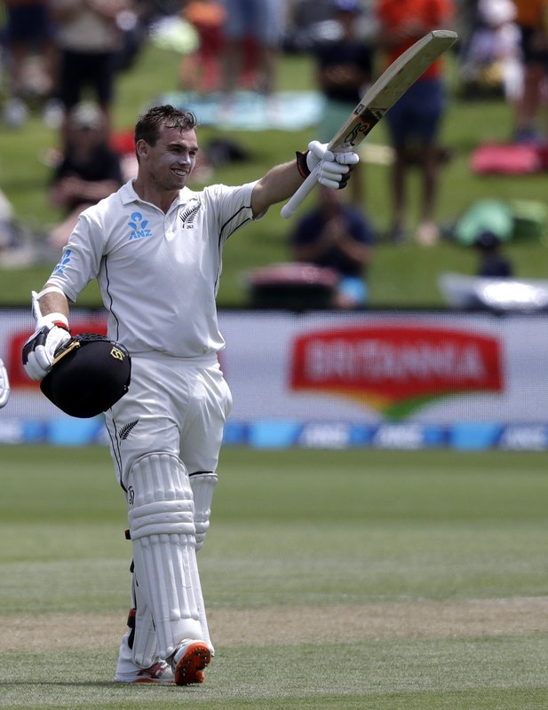 New Zealand's Tom Latham celebrates after scoring a century during play on day three of the second cricket test between New Zealand and Sri Lanka at Hagley Oval in Christchurch, New Zealand, Friday, Dec. (AP Photo/Mark Baker)