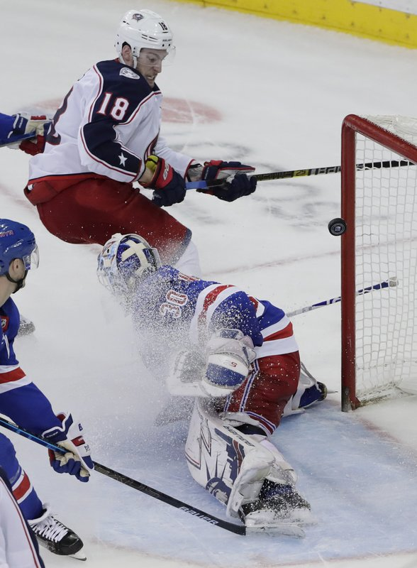 Columbus Blue Jackets' Pierre-Luc Dubois (18) shoots the puck past New York Rangers goaltender Henrik Lundqvist (30) during the overtime period of an NHL hockey game Thursday, Dec. (AP Photo/Frank Franklin II)