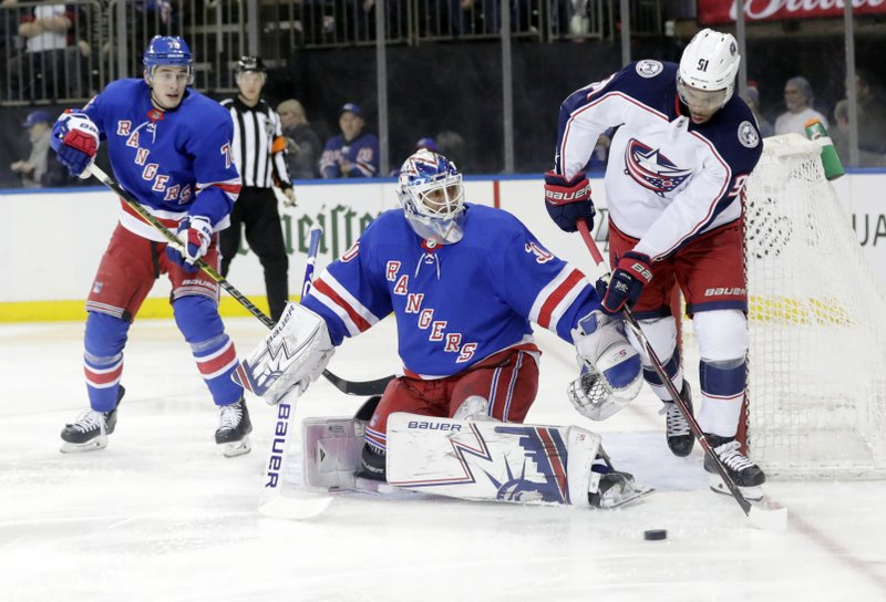 New York Rangers goaltender Henrik Lundqvist, center, watches Columbus Blue Jackets' Anthony Duclair (91) skate behind him during the first period of an NHL hockey game Thursday, Dec. (AP Photo/Frank Franklin II)