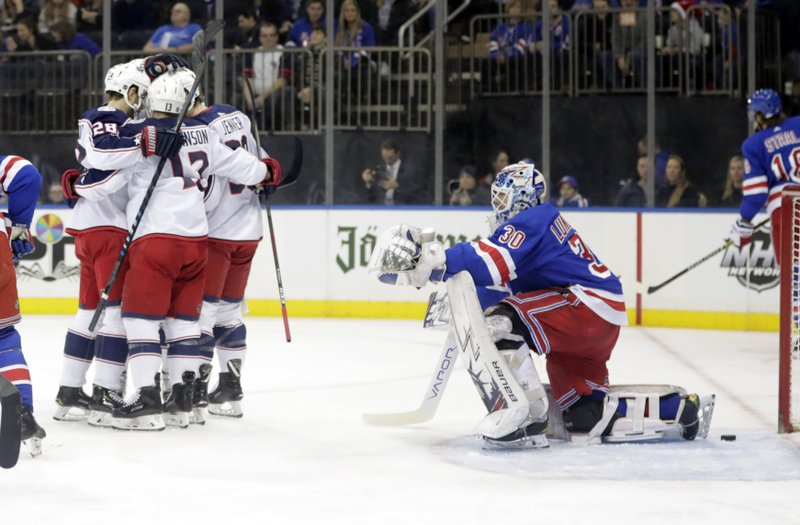New York Rangers goaltender Henrik Lundqvist (30) watches as the Columbus Blue Jackets celebrate a goal by Oliver Bjorkstrand, left, during the first period of an NHL hockey game Thursday, Dec. (AP Photo/Frank Franklin II)