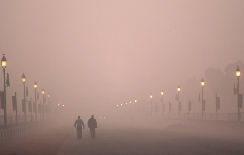 In this Wednesday, Dec. 26, 2018, file photo, people take early morning walk amidst smog in New Delhi, India. (AP Photo/Manish Swarup, File)