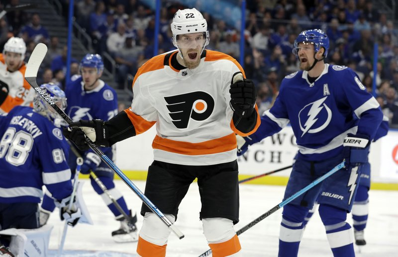 Philadelphia Flyers right wing Dale Weise (22) celebrates after scoring against the Tampa Bay Lightning during the third period of an NHL hockey game Thursday, Dec. (AP Photo/Chris O'Meara)