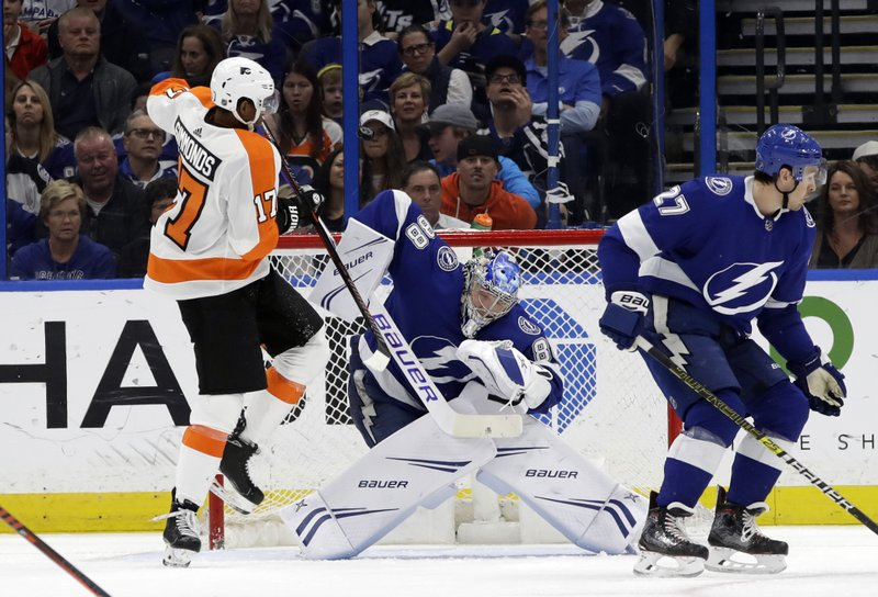 Philadelphia Flyers right wing Wayne Simmonds (17) tries to deflect the puck past Tampa Bay Lightning goaltender Andrei Vasilevskiy (88) during the second period of an NHL hockey game Thursday, Dec. (AP Photo/Chris O'Meara)