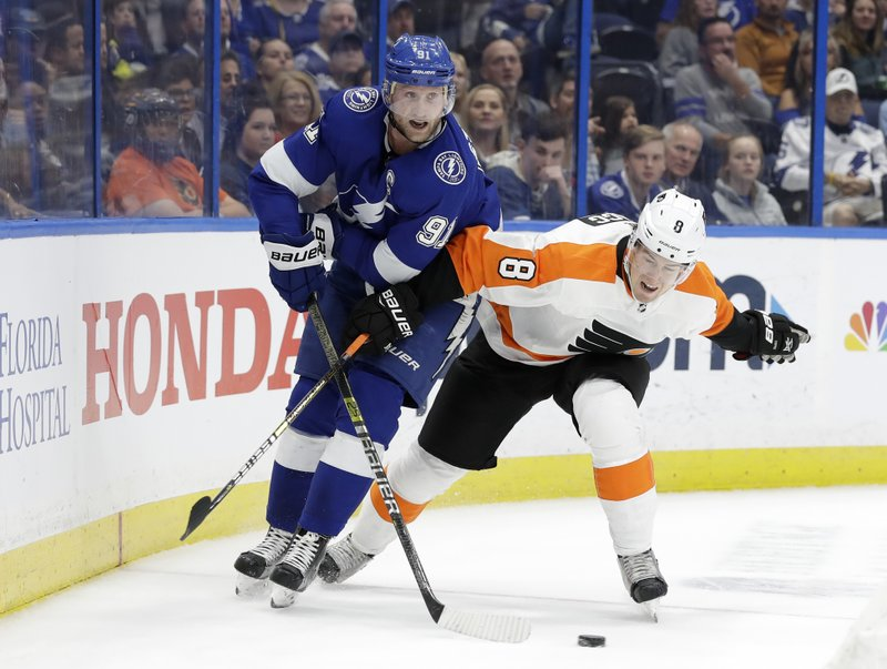 Tampa Bay Lightning center Steven Stamkos (91) and Philadelphia Flyers defenseman Robert Hagg (8) compete for the puck during the second period of an NHL hockey game Thursday, Dec. (AP Photo/Chris O'Meara)