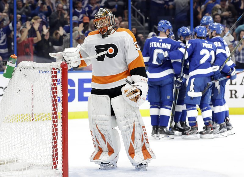Philadelphia Flyers goaltender Michal Neuvirth (30) reacts as the Tampa Bay Lightning celebrate a goal by Tyler Johnson during the second period of an NHL hockey game Thursday, Dec. (AP Photo/Chris O'Meara)