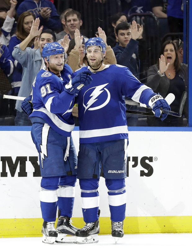 Tampa Bay Lightning center Steven Stamkos (91) celebrates his goal against the Philadelphia Flyers with defenseman Dan Girardi (5) during the second period of an NHL hockey game Thursday, Dec. (AP Photo/Chris O'Meara)