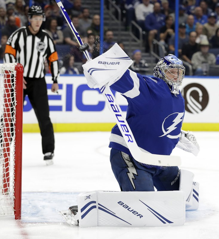Tampa Bay Lightning goaltender Andrei Vasilevskiy (88) makes a blocker save on a shot by the Philadelphia Flyers during the first period of an NHL hockey game Thursday, Dec. (AP Photo/Chris O'Meara)