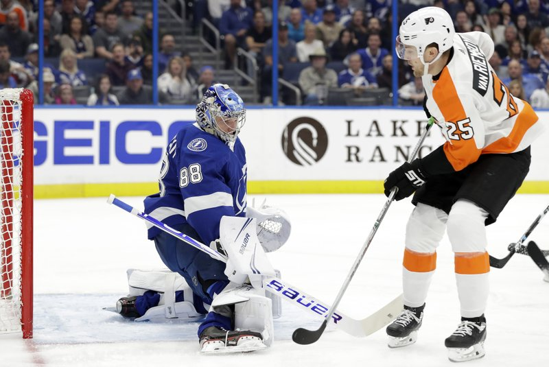 Tampa Bay Lightning goaltender Andrei Vasilevskiy (88) makes a save on a shot by Philadelphia Flyers left wing James van Riemsdyk (25) during the first period of an NHL hockey game Thursday, Dec. (AP Photo/Chris O'Meara)