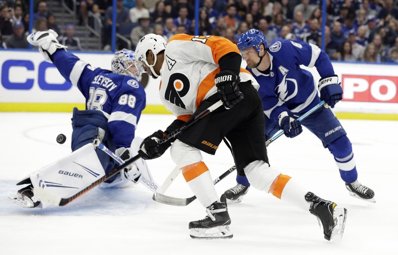 Philadelphia Flyers right wing Wayne Simmonds (17) has his shot stopped by Tampa Bay Lightning goaltender Andrei Vasilevskiy (88) and defenseman Anton Stralman (6) during the first period of an NHL hockey game Thursday, Dec. (AP Photo/Chris O'Meara)