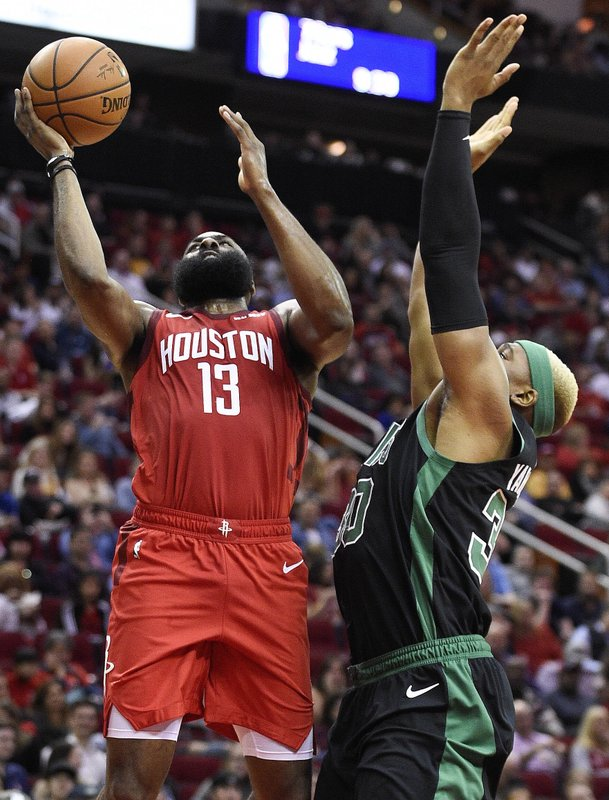 Houston Rockets guard James Harden (13) drives to the basket as Boston Celtics forward Guerschon Yabusele defends during the first half of an NBA basketball game, Thursday, Dec. (AP Photo/Eric Christian Smith)