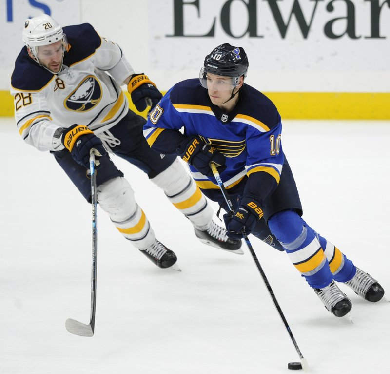 Buffalo Sabres' Zemgus Girgensons (28), of Latvia, chases St. Louis Blues' Brayden Schenn (10) during the third period of an NHL hockey game, Thursday, Dec. (AP Photo/Bill Boyce)