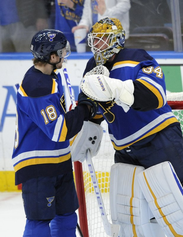 St. Louis Blues goalie Jake Allen (34) is congratulated by teammate Robert Thomas (18) after their victory over the Buffalo Sabres during in an NHL hockey game, Thursday, Dec. (AP Photo/Bill Boyce)