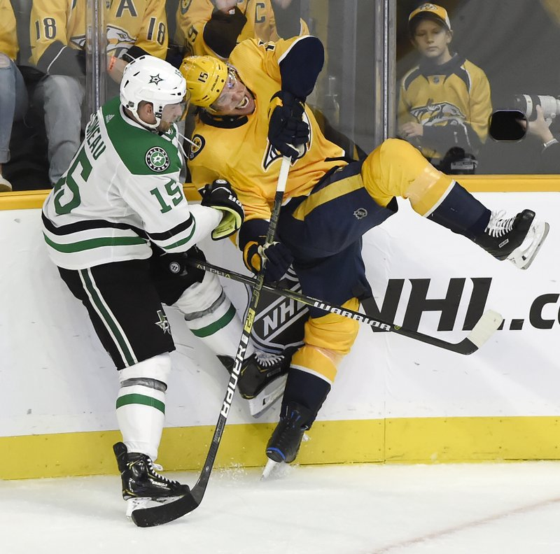 Dallas Stars left wing Blake Comeau, left, collides with Nashville Predators right wing Craig Smith during the third period of an NHL hockey game Thursday, Dec. (AP Photo/Mark Zaleski)