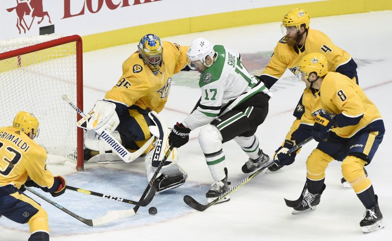 Dallas Stars center Devin Shore (17) attempts to get a shot off against Nashville Predators goaltender Pekka Rinne (35), of Finland, during the third period of an NHL hockey game Thursday, Dec. (AP Photo/Mark Zaleski)