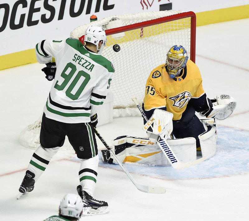 Nashville Predators goaltender Pekka Rinne (35), of Finland, deflects a shot as Dallas Stars center Jason Spezza (90) attempts to get control of the rebound during the first period of an NHL hockey game Thursday, Dec. (AP Photo/Mark Zaleski)