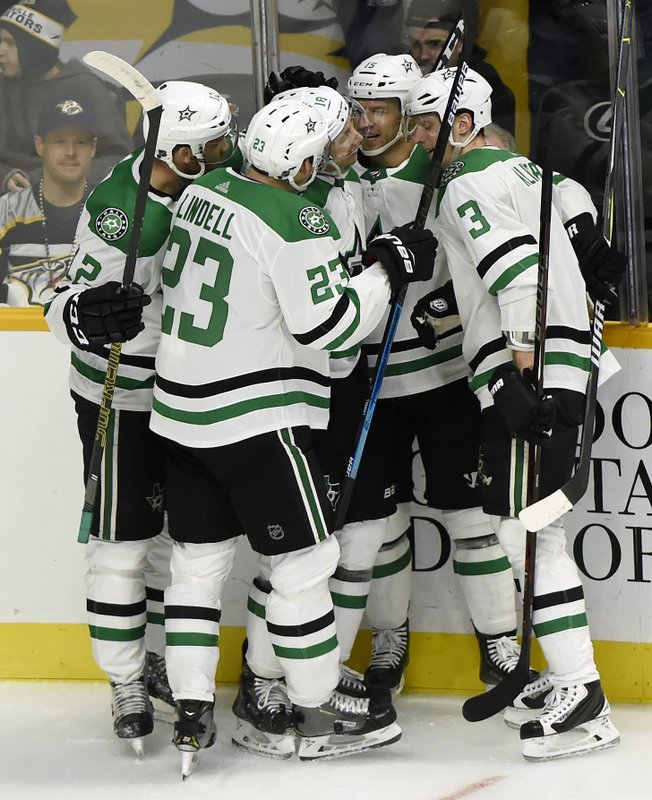 Dallas Stars center Tyler Pitlick (18) celebrates with teammates after scoring a goal against the Nashville Predators during the first period of an NHL hockey game Thursday, Dec. (AP Photo/Mark Zaleski)
