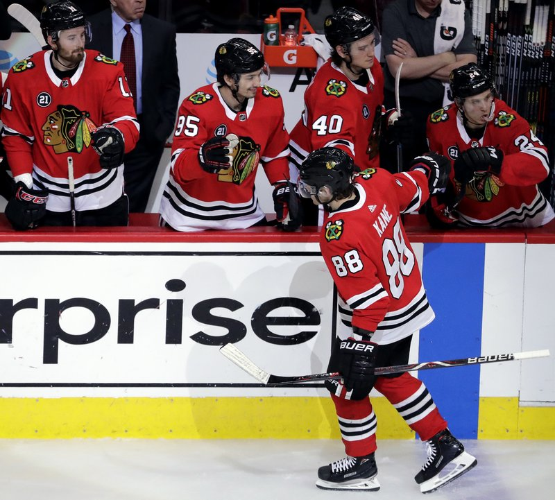 Chicago Blackhawks right wing Patrick Kane (88) celebrates with teammates after scoring his second goal during the second period of an NHL hockey game against the Minnesota Wild, Thursday, Dec. (AP Photo/Nam Y. Huh)