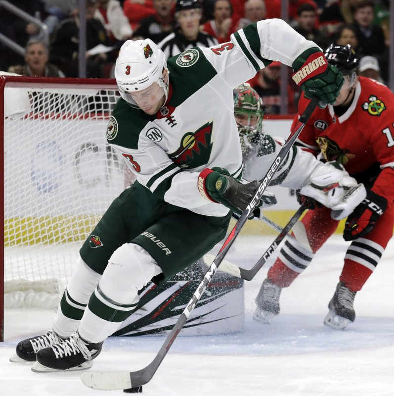 Minnesota Wild center Charlie Coyle (3) controls the puck against the Chicago Blackhawks during the first period of an NHL hockey game Thursday, Dec. (AP Photo/Nam Y. Huh)