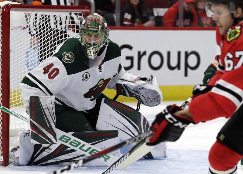 Minnesota Wild goalie Devan Dubnyk (40) watches the puck during the first period of an NHL hockey game against the Chicago Blackhawks, Thursday, Dec. (AP Photo/Nam Y. Huh)