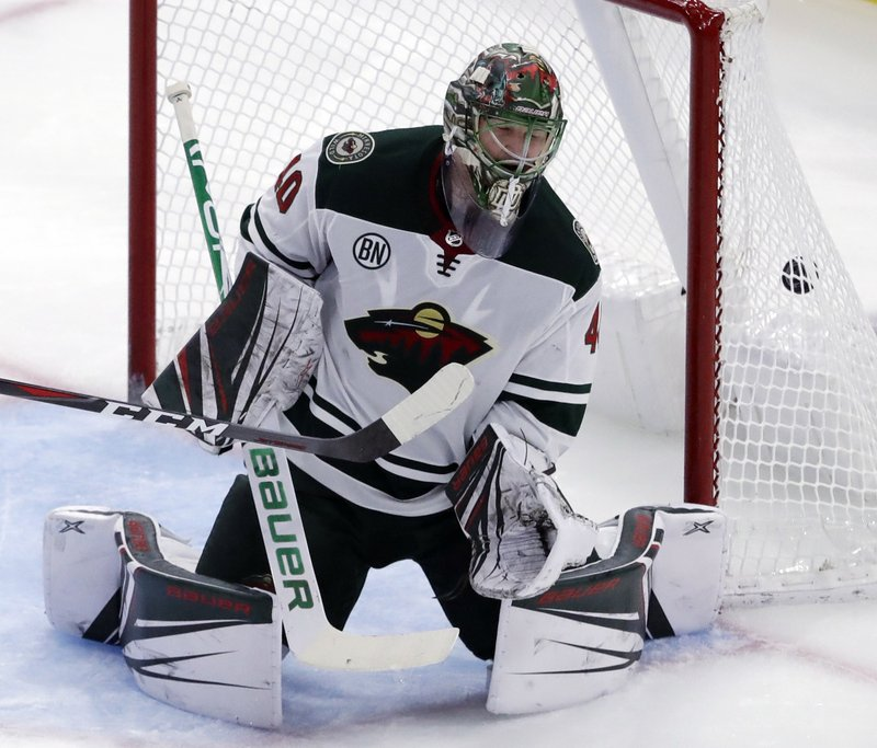 Minnesota Wild goalie Devan Dubnyk cannot stop a goal by Chicago Blackhawks Patrick Kane during the second period of an NHL hockey game Thursday, Dec. (AP Photo/Nam Y. Huh)