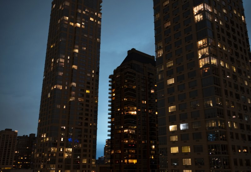 Viewed from the Upper West Side of Manhattan, the night sky is alight as a Con Edison facility in the Queens borough of New York experiences a transformer explosion, Thursday, Dec. (AP Photo/Craig Ruttle)