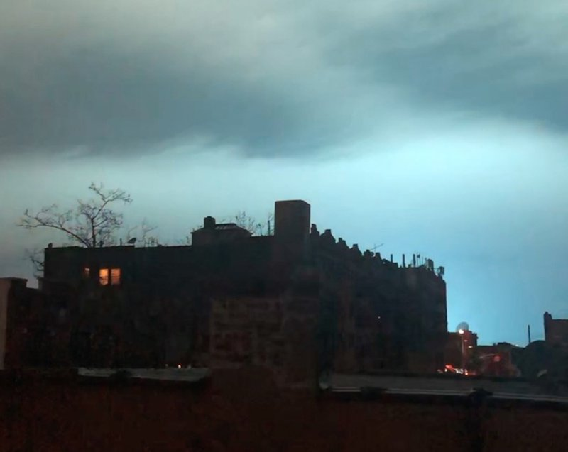 In this image taken from video, the night sky is illuminated in a bright, blue color after an explosion in the Queens borough of New York, Thursday, Dec. (AP Photo/Sophie Rosenbaum)