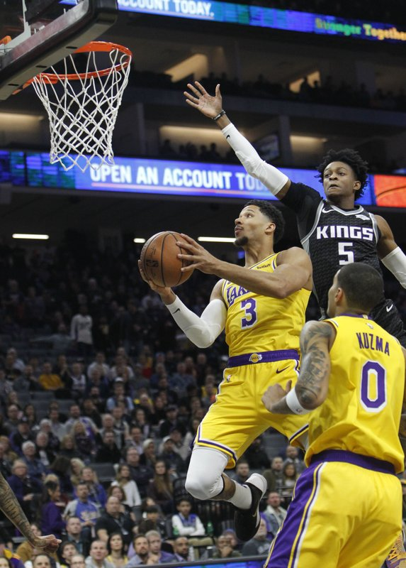 Los Angeles Lakers guard Josh Hart (3) drives to the basket as Sacramento Kings guard De'Aaron Fox (5) defends during the first half of an NBA basketball game in Sacramento, Calif. (AP Photo/Steve Yeater)