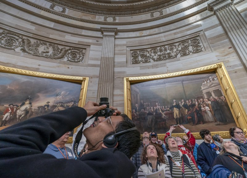 Visitors tour the Capitol Rotunda at the Capitol in Washington, Thursday, Dec. 27, 2018, during a partial government shutdown. (AP Photo/J. Scott Applewhite)