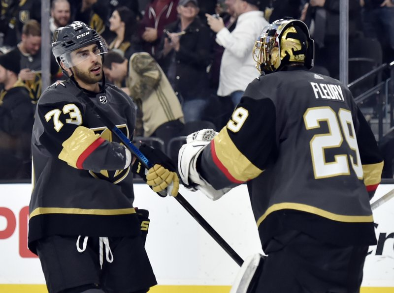 Vegas Golden Knights forward Brandon Pirri (73) gives goaltender Marc-Andre Fleury a fist bump after scoring against the Colorado Avalanche during the third period of an NHL hockey game Thursday, Dec. (AP Photo/David Becker)