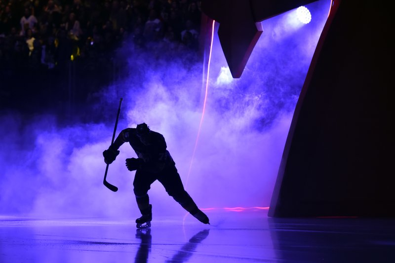 A Vegas Golden Knights player takes the ice before the team's NHL hockey game against the Colorado Avalanche on Thursday, Dec. (AP Photo/David Becker)