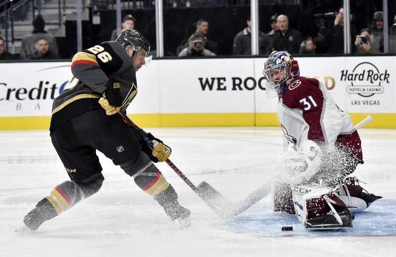 Vegas Golden Knights center Paul Stastny (26) shoots against Colorado Avalanche goaltender Philipp Grubauer (31) during the second period of an NHL hockey game Thursday, Dec. (AP Photo/David Becker)