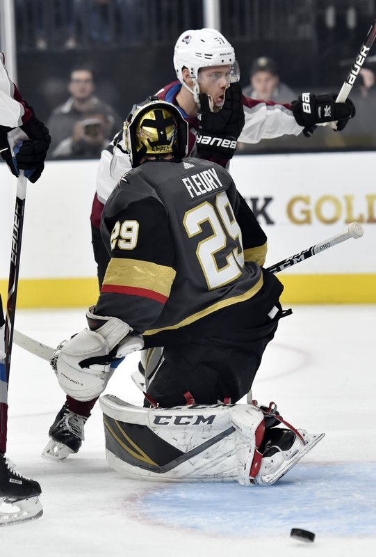 Colorado Avalanche left wing J.T. Compher (37) reacts after scoring against Vegas Golden Knights goaltender Marc-Andre Fleury during the first period of an NHL hockey game Thursday, Dec. (AP Photo/David Becker)