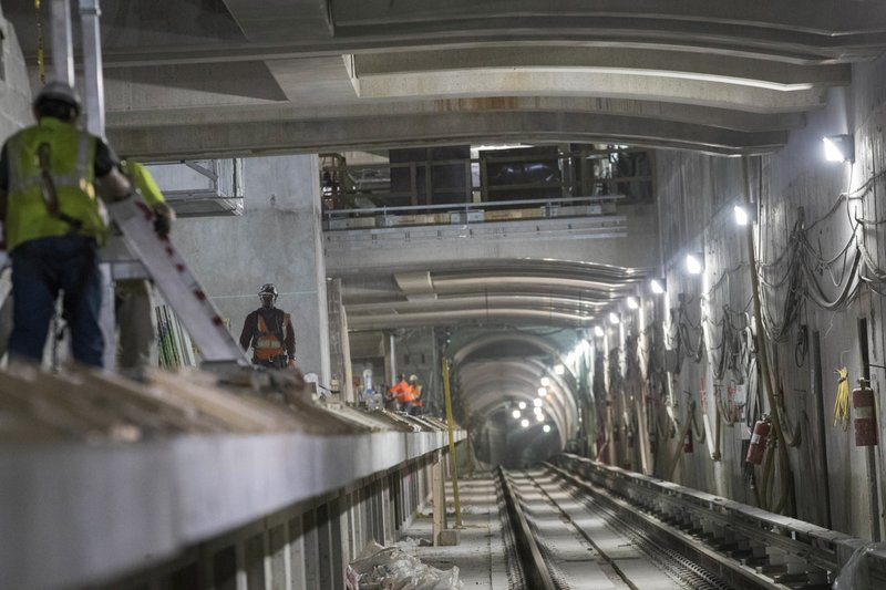 In this Nov. 29, 2018 photo, construction crews work on a track platform of the East Side Access project beneath Grand Central Terminal in New York. (AP Photo/Mary Altaffer)