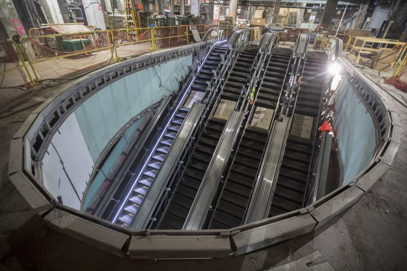 This Nov. 29, 2018 photo shows one of four escalators that will carry passengers from the concourse level to the mezzanine and train platforms of the East Side Access project beneath Grand Central Terminal in New York. (AP Photo/Mary Altaffer)