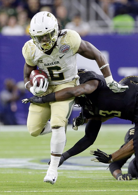 Baylor running back JaMycal Hasty (6) is tackled by Vanderbilt defensive back Tae Daley (3) during the first half of the Texas Bowl NCAA college football game Thursday, Dec. (AP Photo/Michael Wyke)