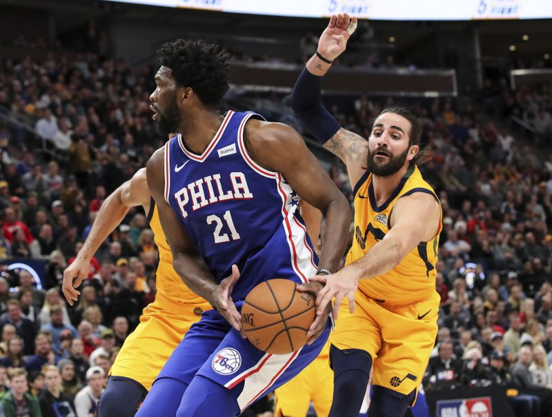 Utah Jazz guard Ricky Rubio tries to steal the ball from Philadelphia 76ers center Joel Embiid (21) during the second quarter of an NBA basketball game Thursday, Dec. (AP Photo/Chris Nicoll)