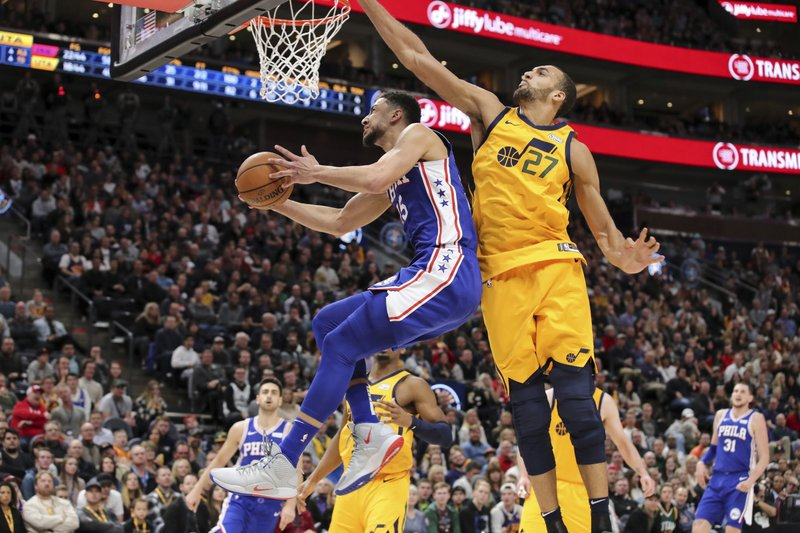 Philadelphia 76ers guard Ben Simmons (25) gets past Utah Jazz center Rudy Gobert (27) and looks to the basket during the second quarter of an NBA basketball game Thursday, Dec. (AP Photo/Chris Nicoll)