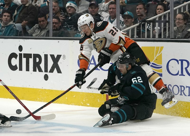 Anaheim Ducks defenseman Brandon Montour (26) battles for the puck against San Jose Sharks right wing Kevin Labanc (62) during the first period of an NHL hockey game in San Jose, Calif. (AP Photo/Tony Avelar)