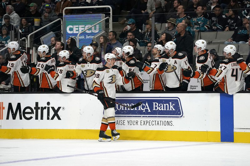 Anaheim Ducks right wing Jakob Silfverberg (33) is congratulated by teammates after scoring a goal against the San Jose Sharks during the first period of an NHL hockey game in San Jose, Calif. (AP Photo/Tony Avelar)