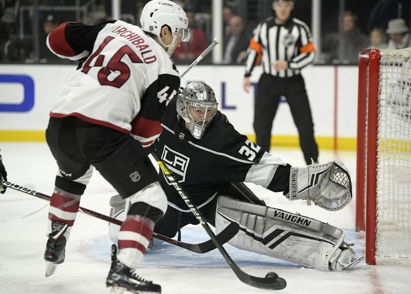 Arizona Coyotes right wing Josh Archibald, left, tries to score on Los Angeles Kings goaltender Jonathan Quick during the first period of an NHL hockey game Thursday, Dec. (AP Photo/Mark J. Terrill)